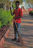 Man is sweeping the street in Ahmedabad, India Royalty Free Stock Image