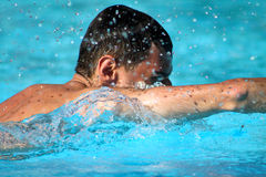 Man swim in blue water Stock Photo