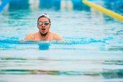 Man swim in pool lane royalty free stock image