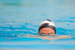 Man swim in pool underwater stock photos