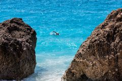 A man swim in the sea at the Kavalikefta Beach in Lefkada Island. Greece Royalty Free Stock Images