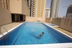 Man swim in swimming pool at roof, bahrain Royalty Free Stock Photo