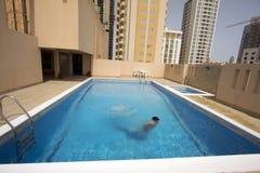Man swim in swimming pool at roof, bahrain Royalty Free Stock Photo