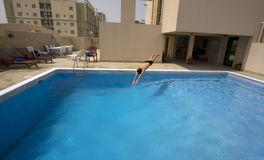 Man swim in swimming pool at roof, bahrain Royalty Free Stock Image