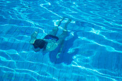 Man swim under water. Photo of the young Man swim under water Royalty Free Stock Photo