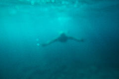 Man swim underwater sea abstract background Royalty Free Stock Images