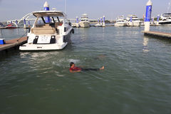 Man swim in the wuyuanwan yacht marina Royalty Free Stock Photo