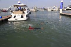 Man swim in the wuyuanwan yacht marina Royalty Free Stock Photo