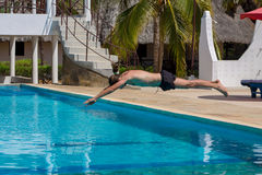 Man in the swiming pool. Young man jump in the swiming pool at tropical resort luxury hotel Royalty Free Stock Photo