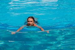 Man in the swiming pool Royalty Free Stock Images