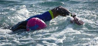 Man swimmer swimming crawl in blue sea. Training for triathlon Stock Photography