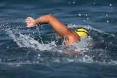 Man swimmer swimming crawl in blue sea. Training for triathlon Stock Photo