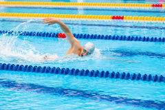 Man swimmer swimming crawl in blue water. Royalty Free Stock Image