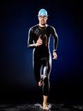 Man swimmer swimming triathlon ironman isolated. One caucasian man triathlon ironman swimmer swimming isolated stock images