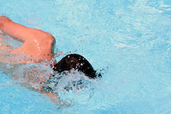 Man swimming. Crawl in swimming pool Royalty Free Stock Photo