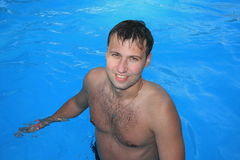 Man swimming. Crawl in swimming pool Stock Photography