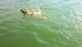 Man swimming in big pool Stock Photos
