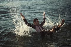Man swimming with business suit Royalty Free Stock Images