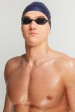 Man in swimming cap. Young athletic man in swimming cap and googles stock image