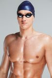 Man in swimming cap. Young athletic man in swimming cap and googles stock photo
