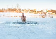 Man swimming cold water. Man swimming in cold water a frosty morning Stock Image