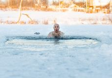 Man swimming cold water Royalty Free Stock Images