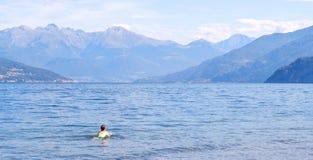 Man swimming in Lake Como stock photos
