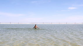 Man swimming in the lake. stock footage