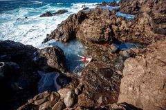 Man swimming in the natural pool. Near Buenevista del Norte village on Tenerife island in Spain Royalty Free Stock Image