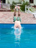 The man is swimming in the pool.  Royalty Free Stock Photo