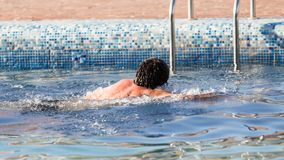 The man is swimming in the pool.  Royalty Free Stock Photography
