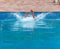 The man is swimming in the pool.  Stock Images