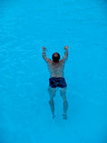 Man swimming in a pool Royalty Free Stock Photo