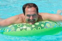 Man in swimming pool Stock Photography