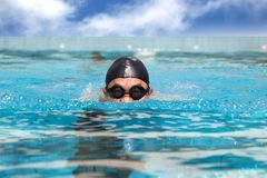 Man in the Swimming pool. With breast stroke Royalty Free Stock Images