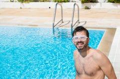 Man at swimming pool Stock Photo