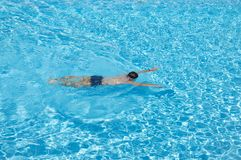 Man swimming  in the pool alone. Summer vacation. Royalty Free Stock Photography