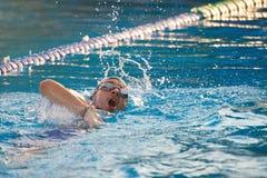 Man swimming in pool stock photo