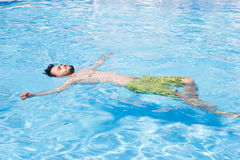 Man swimming in the pool. blue water, summer, Stock Photos
