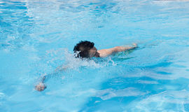 Man swimming in the pool. blue water, summer, Royalty Free Stock Image