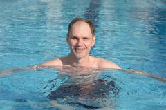 Man in a swimming pool Stock Photo