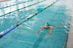 Man swimming in pool at leisure center Royalty Free Stock Photography