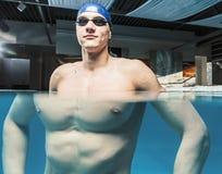 Man in swimming pool Stock Photo
