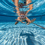 Man in swimming pool Royalty Free Stock Photography
