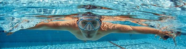 Man in swimming pool royalty free stock image