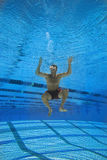 Man in swimming pool, underwater view Royalty Free Stock Image