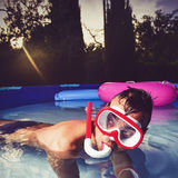 Man swimming in a portable swimming pool Royalty Free Stock Photos