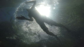 Man swimming in the sea above the camera stock video footage