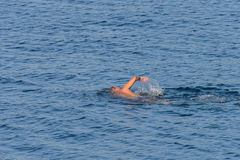 Man is swimming in the sea Royalty Free Stock Photography