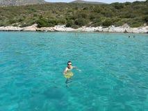 Man swimming in a sea Stock Photos